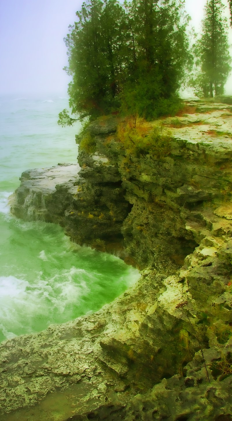 Stormy weather comes to Cave Point in Wisconsin's Door County in this image captured by Behreandt Visuals Photography.