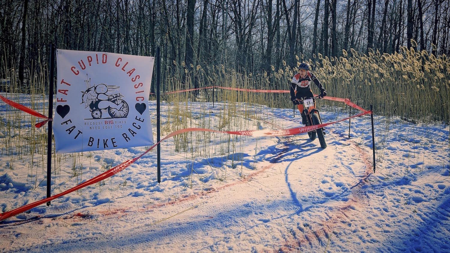 A fat bike racer rounds a corner during the Fat Cupid Classic held in Appleton Wisconsin.