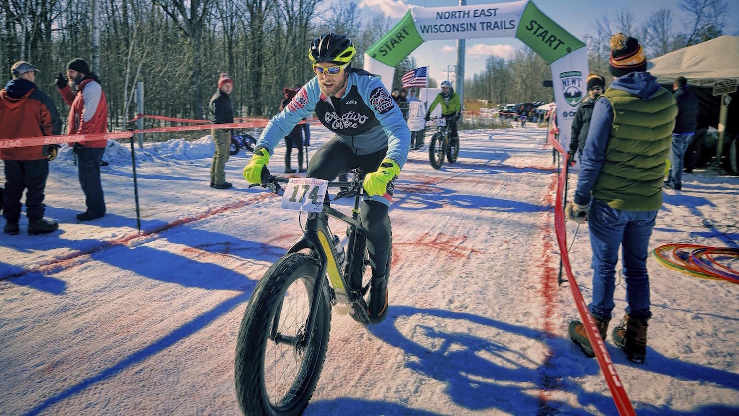 A competitor rides through the start/finish line of the Fat Cupid Classic.