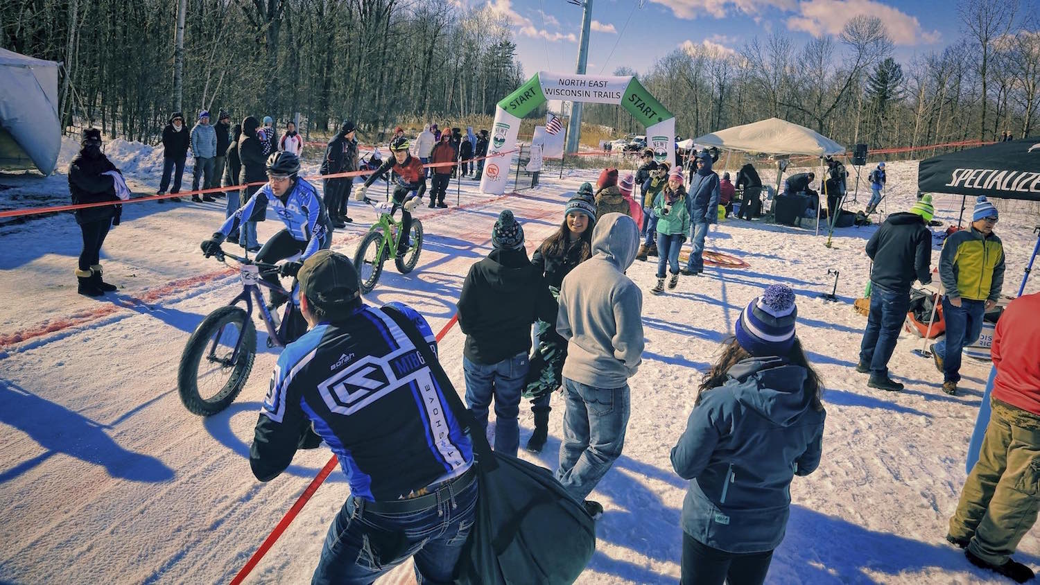 The crowd cheers on competitors at the start/finish line of the Fat Cupid Classic fat bike race.
