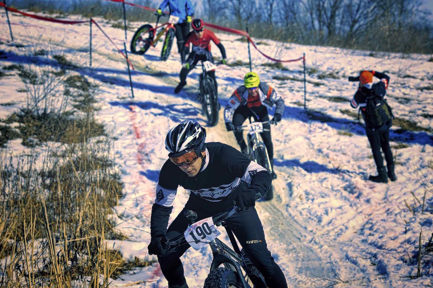 Fat bike racers tackle a slippery descent during the Fat Cupid Classic.